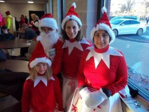 Participants enjoy the festivities at the Santa Run, Walk & Ride.