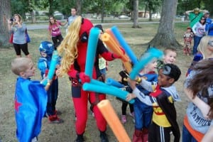 Kids battle villains at the Kids in Capes! Superhero Walk/Run