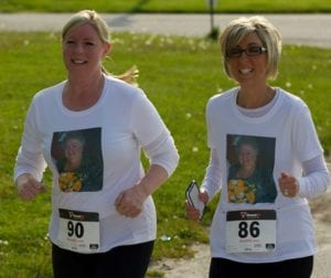 Participating in memory of their Mom at the Run Like a Mother 5K.