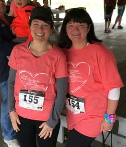 A Mom with her daughter at the Run Like a Mother 5K.